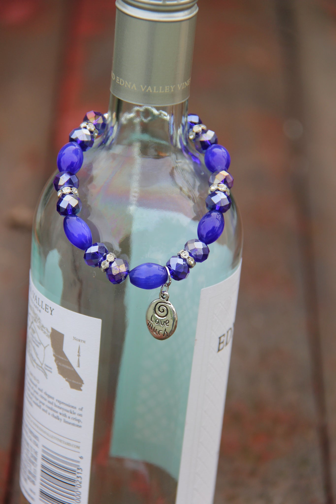 Love much & Laugh Often silver charm navy blue bottle bracelet
