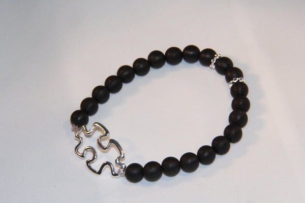 Black wood bracelet with Autism charm