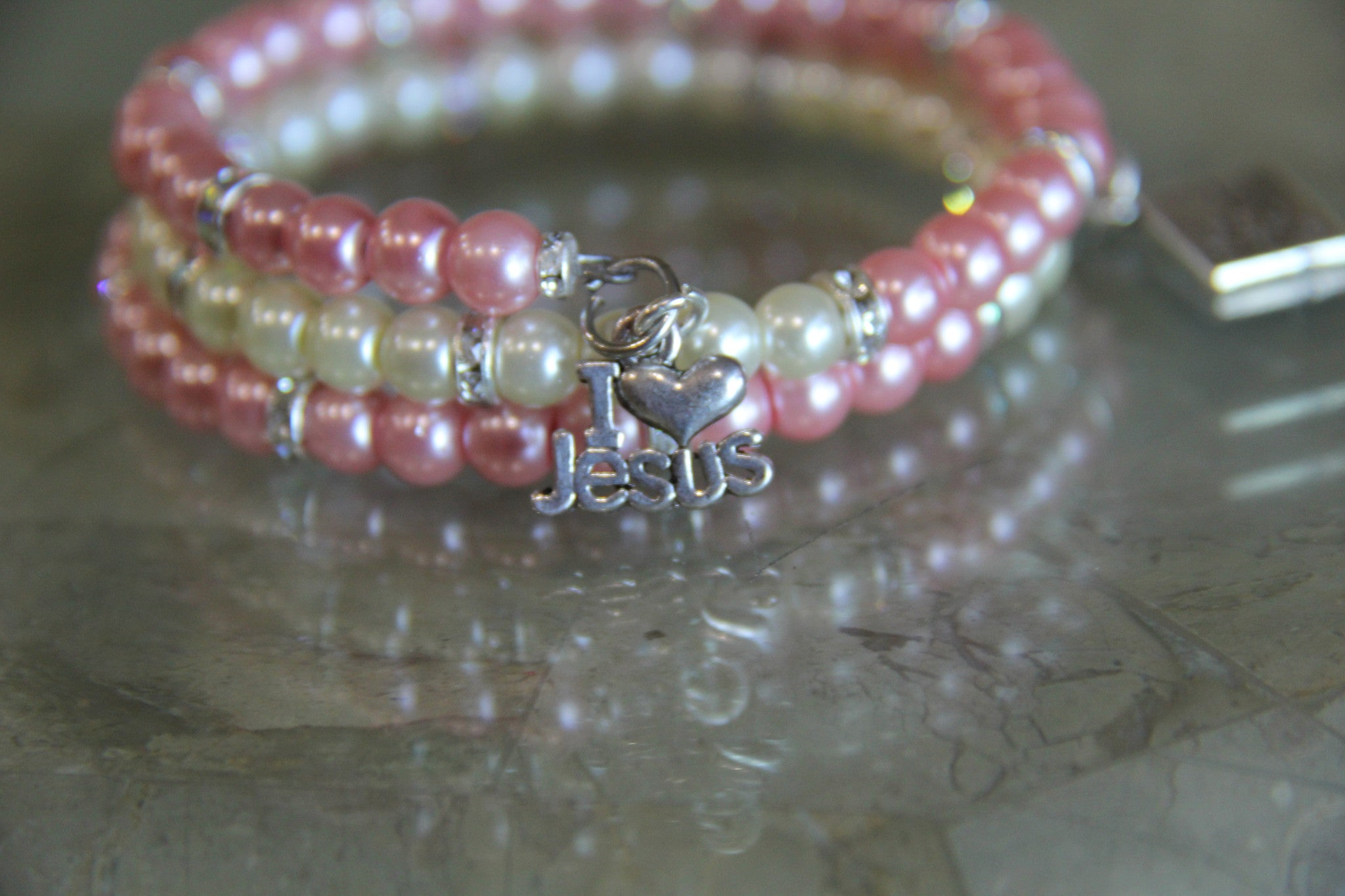 Spring bracelet made with pink and white glass pearl beads