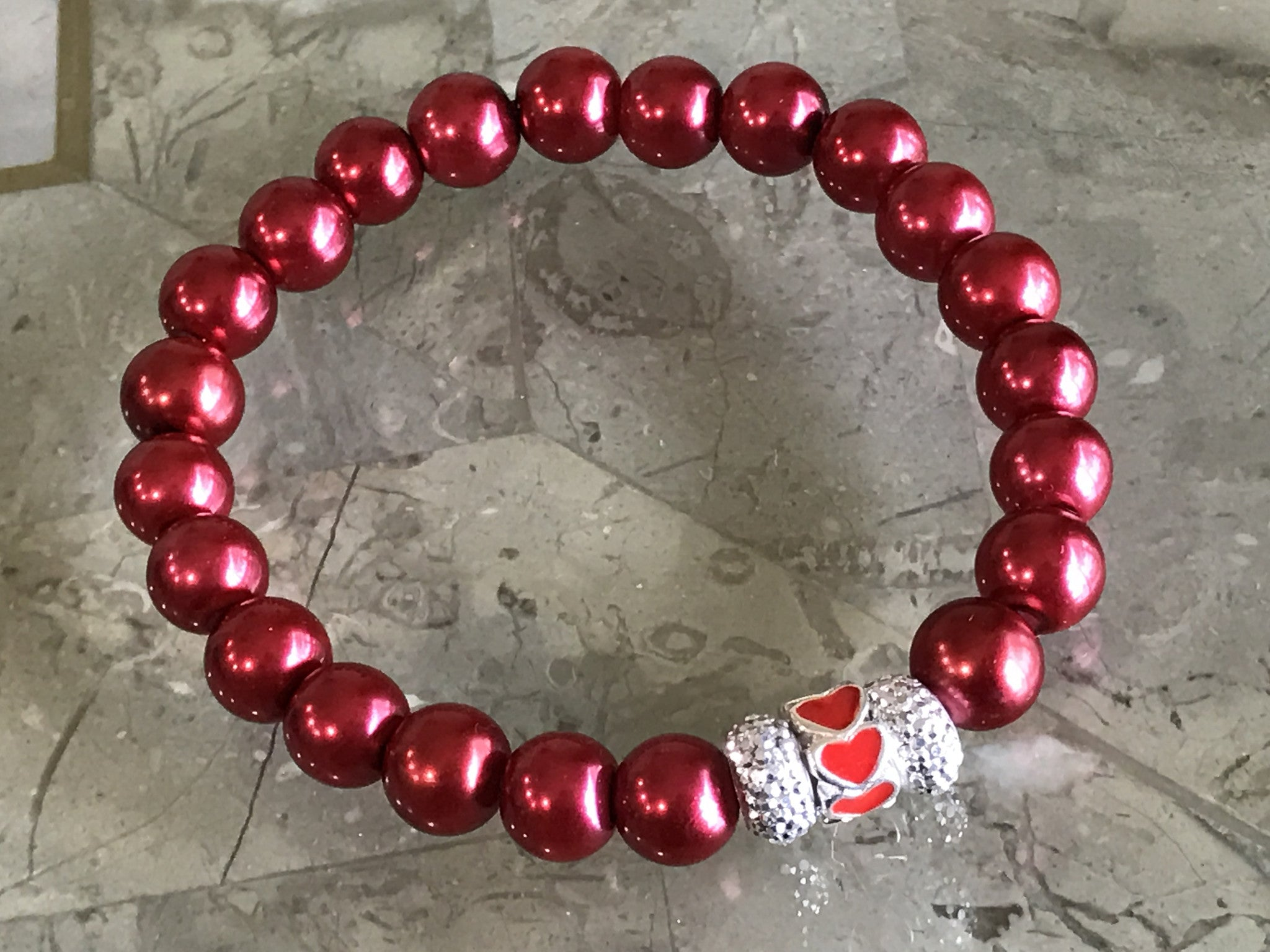 Red pearl glass beads bracelet with an European hearts charm