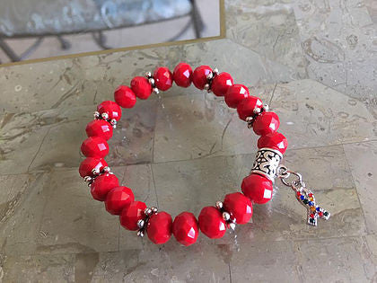 Red rondelle glass beads with Autism charm