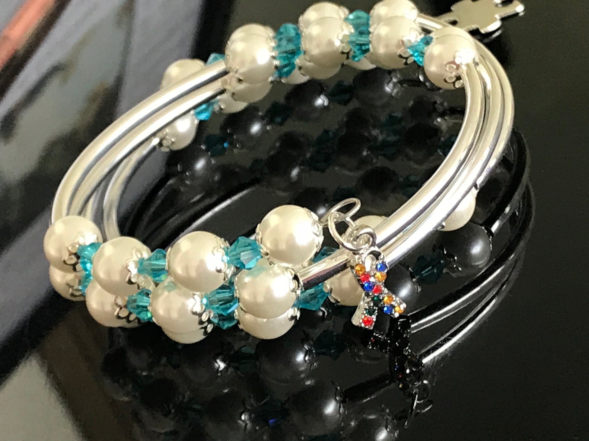 Autism awareness white glass pearls, Swarovski with silver noodle beads on a memory wire bracelet
