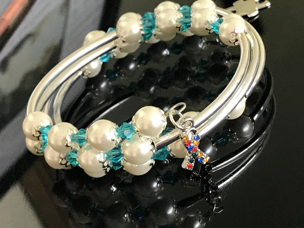 Autism awareness white glass pearls, turquoise Swarovski with silver noodle beads on a memory wire bracelet
