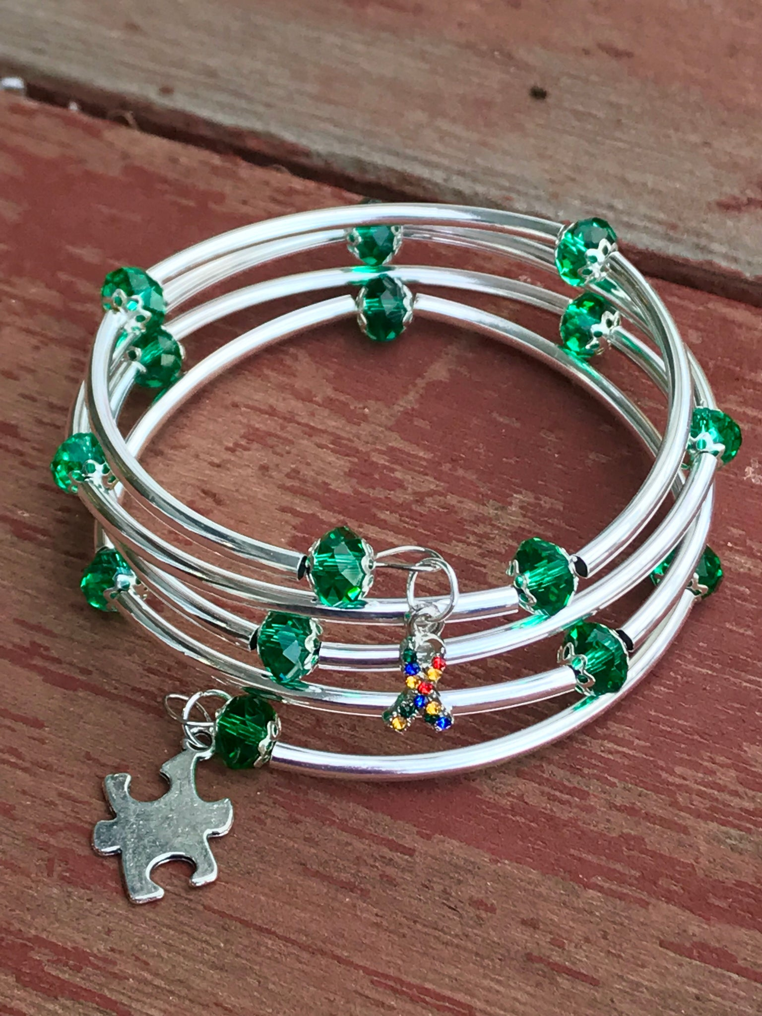 Autism awareness bracelet memory wire dark green crystal silver noodle beads