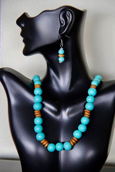 Aqua and beige colored disc wooden beads