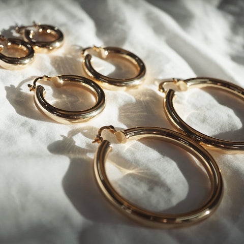 Our newly designed LEXI thick hoop earrings are the perfect day to night accessory to style with any outfit.