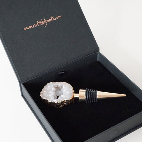 Agate crystal bottle stopper with an electroplated gold gilded gold edging. Arrives in our black branded luxury gift packaging.
