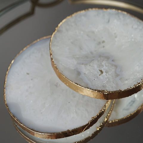 Our white agate crystal coasters made from a natural geode slice and a painted gilded edge. The perfect gift for homeware lovers.