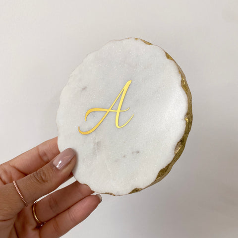 Make your gift personal with an initial of your choice displayed upon our solid marble coaster with a gold leaf edging.