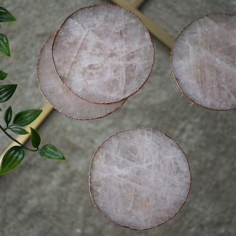 Our rose quartz crystal coasters with a beautiful rose gold electroplated edge.
