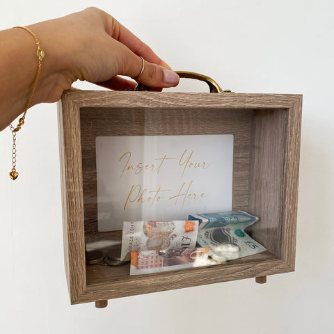 Our custom photo money fund box is a beautiful way to save your pennies whilst displaying it in your home.
