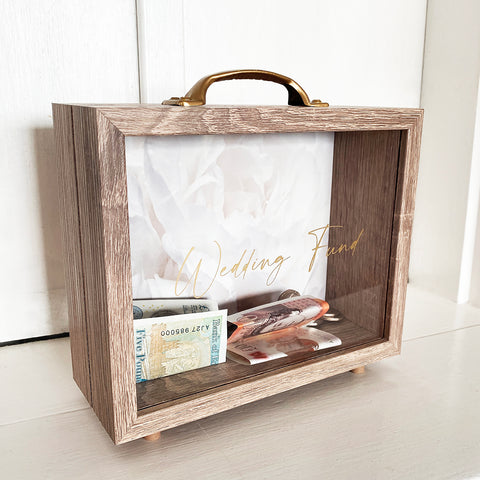 Our new and improved design of our wedding fund money box. The perfect gift for a newly engaged couple saving for their big day.