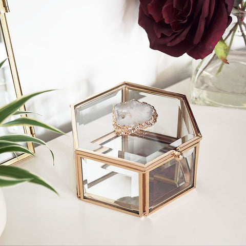 Our hexagonal glass trinket box with mirrored base and natural agate crystal slice. Store your earrings, bracelets and watches, keeping them protected whilst adding to your bedroom or dressing room decor.