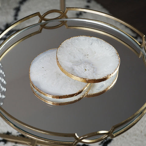 Our white agate crystal coasters with a gold electroplated metallic edge are a beautiful coffee table accessory.