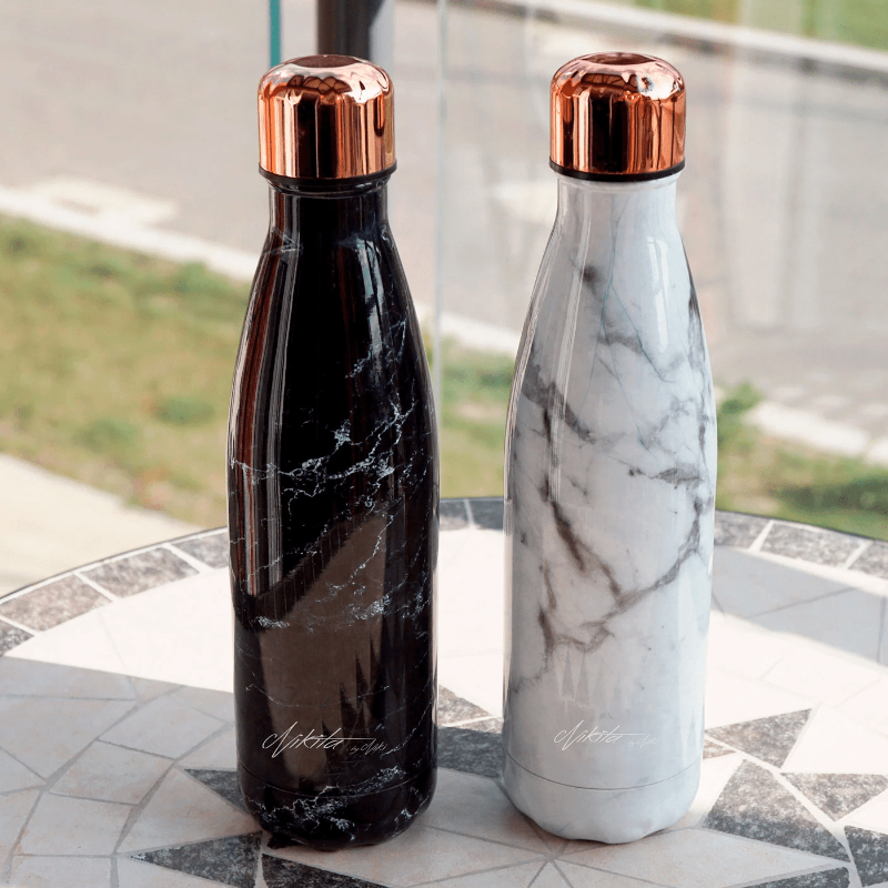 Metal water bottles in black and white with rose gold lids by Nikita By Niki
