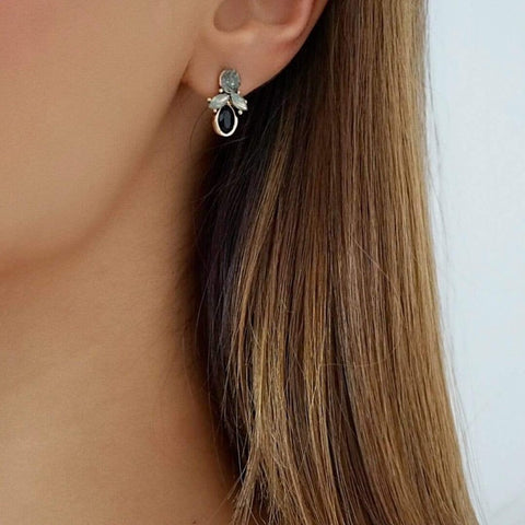 Our SKYLER statement earrings encrusted with black rhinestones on a quality gold plated base. This drop stud earring can be matched with the SKYLER choker for the ultimate set.