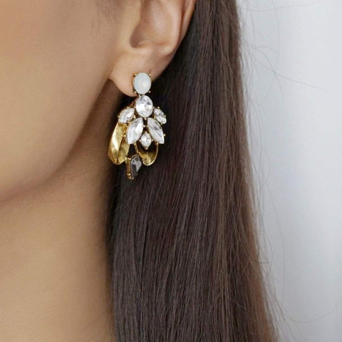 The LEILANI statement earrings, with a rhinestone encrusted design and antique plated metal base. A beautiful dangling ear accessory to wear with matching LEILANI necklace or choker.