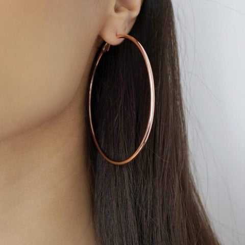 Our VENICE extra large hoop earrings in rose gold are made to be oversized and include a quality polished plated metal base. The big hoop is a must have in any jewellery box.