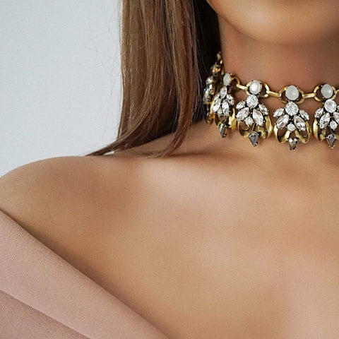 The LEILANI gold statement choker, made from quality plated metal and rhinestone encrusted. Our black, white and gold shorter version of the LEILANI necklace.