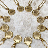 Our ZODIAC star sign necklace is an 18k gold plated design the features a small round disc pendant with a visual script and symbol on a delicate gold chain. A symbol yet stylish design that is personal to you.