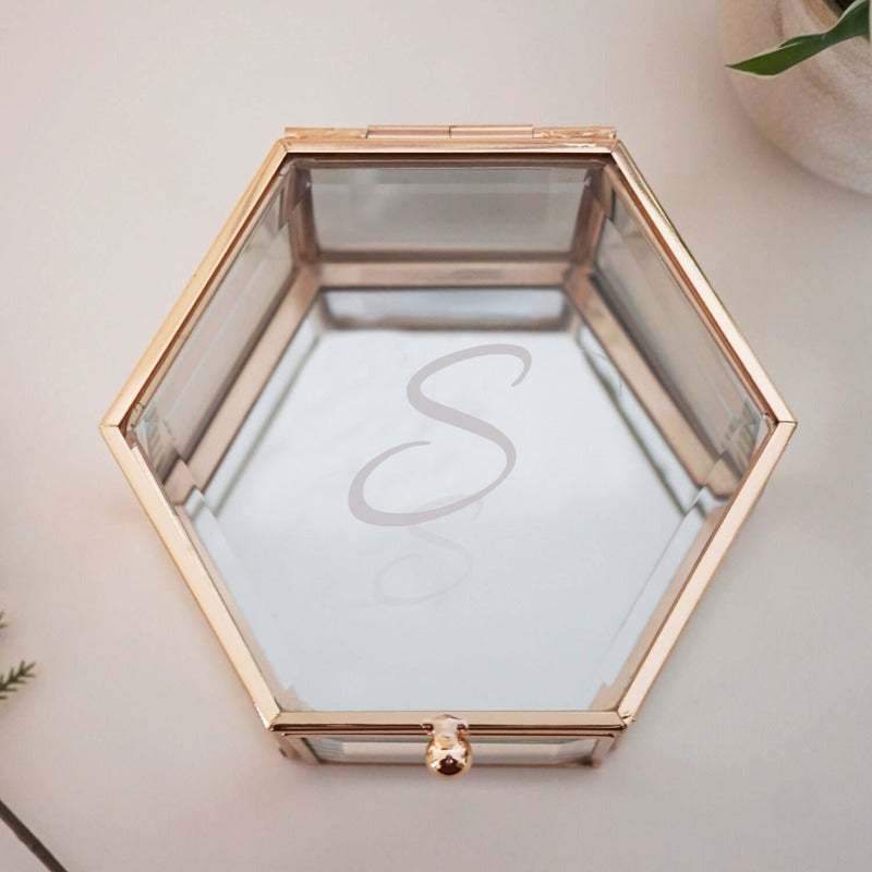 Personalised initial glass jewellery trinket box with a mirrored base and glass with plated metal hexagonal shape. Select an initial of your choice to be etched by hand to add the personal touch.