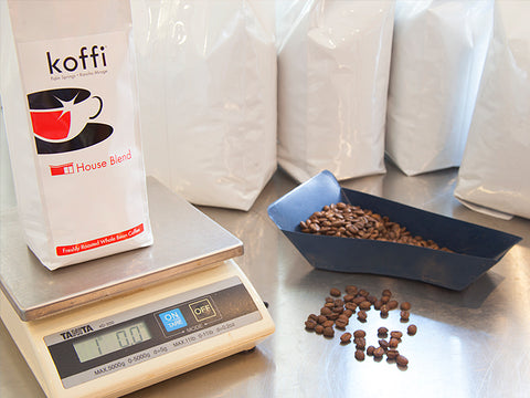 Koffi coffee beans and scale