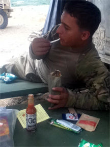 Josh from the Armed Services enjoying hot sauce from The Scoville Food Institute.