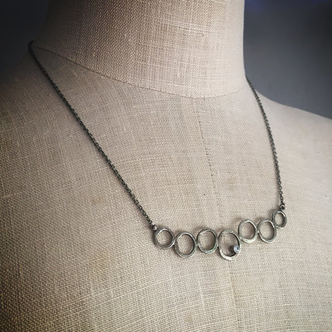 Oxidized nucleus necklace