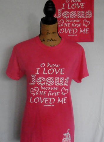 christian t shirt for adults and children in pink, teal and blue with words to hymn O How I Love Jesus because He first Loved me.  Jesus letters are done in chevron design.  New design has logo on bottom hem or on back of children's shirt