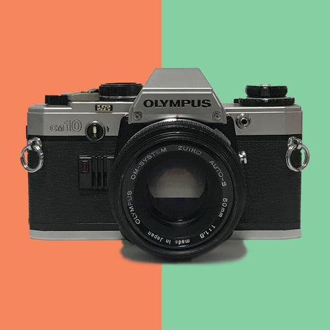 Olympus OM10 50mm f/1.8 (with leather case)