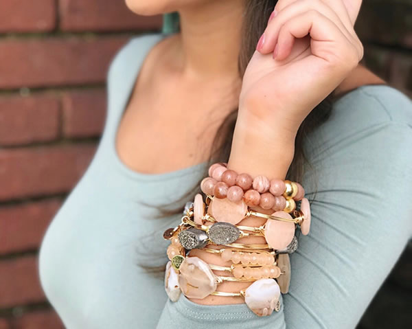 Arm full of Bangle Bracelets by Bourbon and Boweties