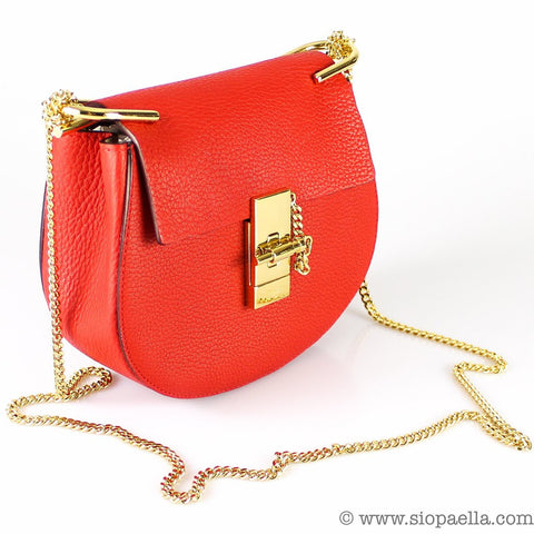 de8dbc187cc70d Another pretty little red bag, we know- but who says you can't have more  than one?! The Chloe 'drew' bag was a blogger hit a few years ago and it  still ...