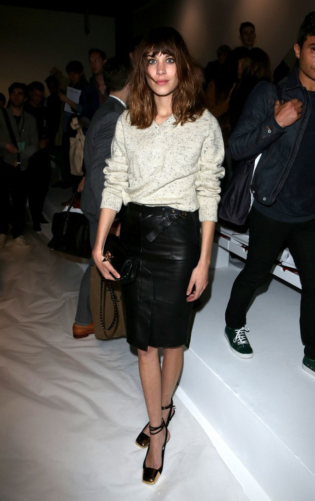 LONDON, ENGLAND - JUNE 15: Alexa Chung on the front row for the Martine Rose Spring/Summer 13 collection at The Hospital Club on June 15, 2012 in London, England. (Photo by Tim Whitby/Getty Images)