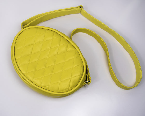 yellow oval crossbody bag quilted