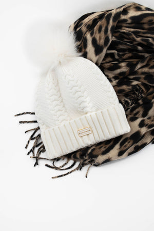 Park and Buzz leopard print scarf with fringe and cozy cable knit toque with fur Pom Pom.