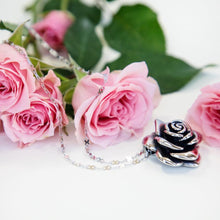 Load image into Gallery viewer, Large stainless steel rose pendant on our stainless steel infinity chain set by pink roses. This pendant will not tarnish or dent. Lovely rose flower pendant.