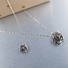 "Load image into Gallery viewer, The medium and small stainless steel rose pendants on our infinity ribbon stainless steel chain. Medium pendant is about 11/4"" long and the small pendant is about 1"" long."