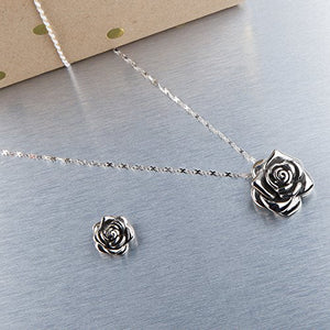 "The medium and small stainless steel rose pendants on our infinity ribbon stainless steel chain. Medium pendant is about 11/4"" long and the small pendant is about 1"" long."