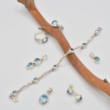 "Load image into Gallery viewer, Blue Topaz round semi-precious stone Sterling Silver toggle Bracelet, 925 silver 7""-8"" 6 blue topaz stones. Shown also is a ring to match as well as pendants and earrings."