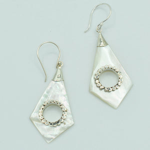 Abalone or Mother of Pearl Sterling Silver Earrings. Geometric diamond shape. Silver work. one and a quarter inch long. Pierced earrings. Fish hook There is a whole cut out in the center with silver scalloped around the edge of the whole.