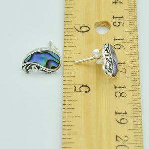 Abalone and Sterling Silver Stud Earrings. Pierced stud earrings with abalone and sterling silver scroll work. Less than a half in ch in size.