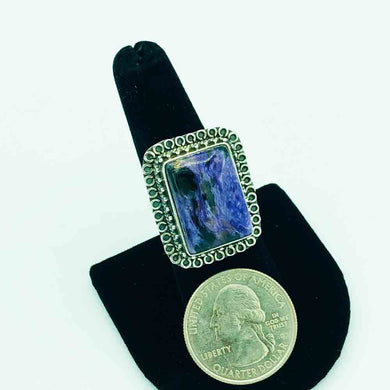 Charoite and Sterling Silver Ring-size 8. Shown with a quarter to judge the size. The face of the ring is about the size of a quarter although the ring is a rectangle shape.