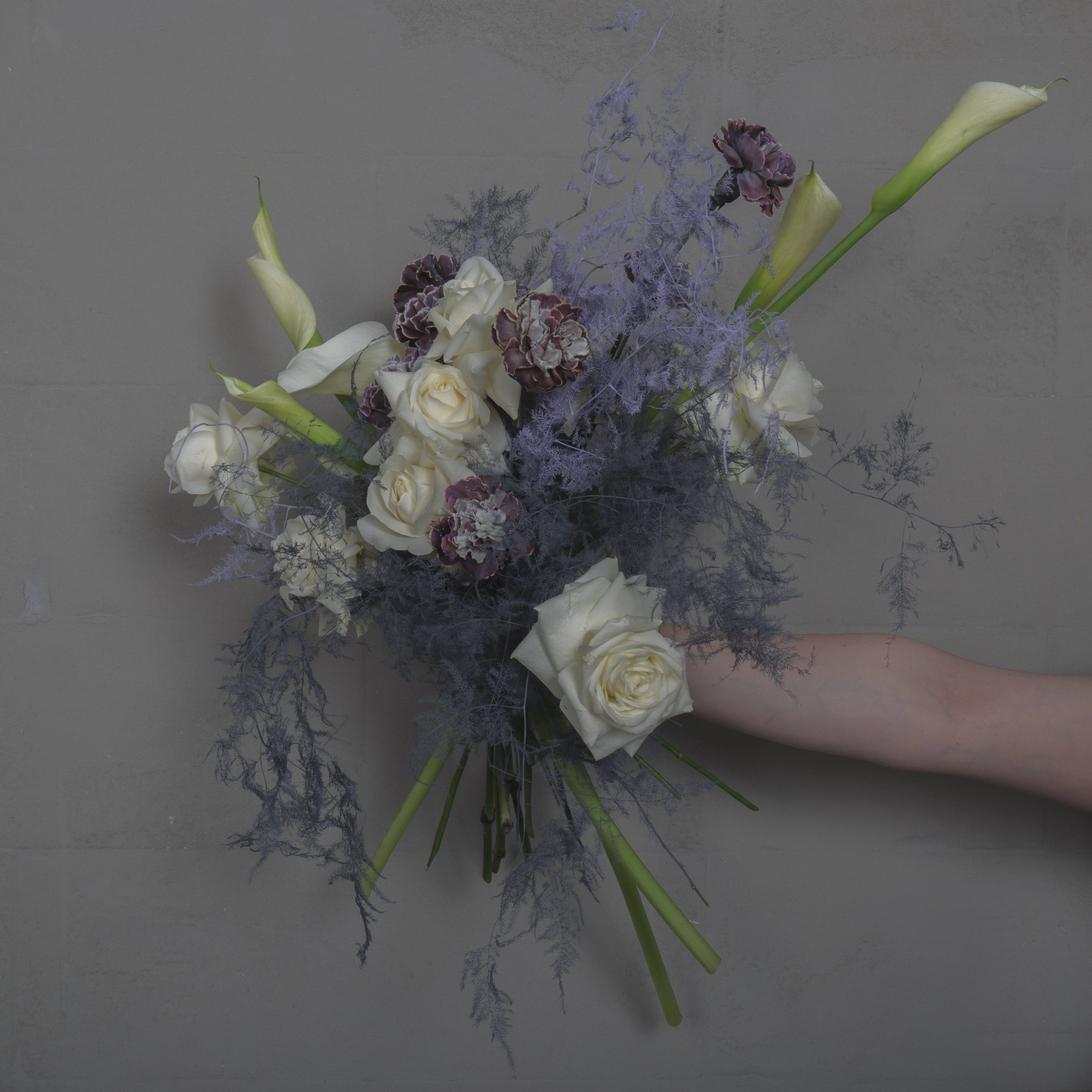 Wedding-bouquet-of-Finecut-weddings-collection-8-2019-lilac-and-white-with-fully-bloomed-roses-callas-lilac-dyed-asparagus-fern-and-striped-carnation-with-amaranth-tails-and-branches-of-almond