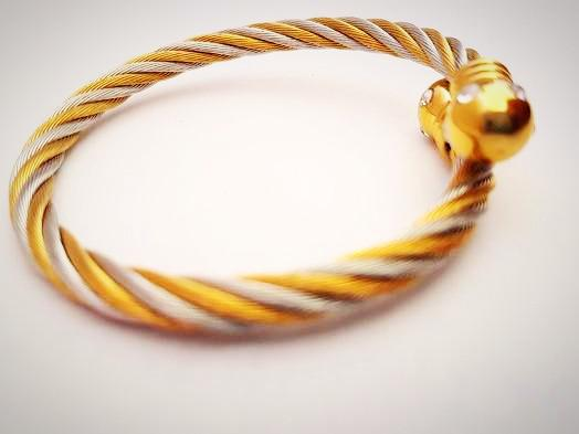 RN-581 Gold and silver wired bangle that can be worn on any outfit and comes in an adjustable size