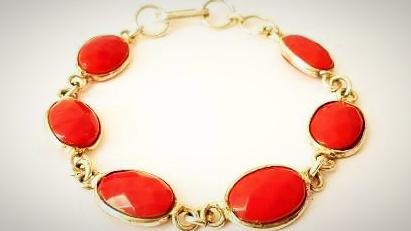 RN-704 Coral stones line up to make this vintage bracelet in silver typically from the Victorian Era