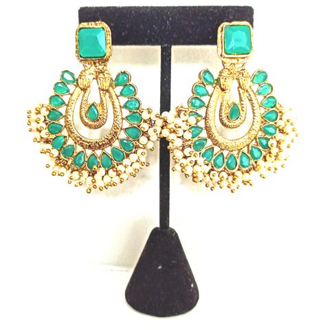 TR 35 Traditional green stoned earrings with small dense pearls adding glamour to the look