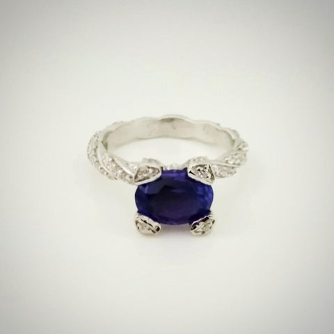 RV 414 A Royal bluish purple hued Tanzanite set in silver to make a gorgeous ring in a crossover setting never seen before!