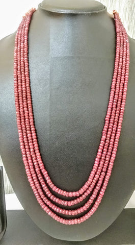 NP -34 Pomegranate red rubies in 4 lines make this fascinating necklace . Rich in look and color