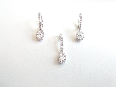 RV 346 Brilliant cut oval diamond earrings with a line of round diamonds made in 18 kt white gold, Matching pendant available (price on request)