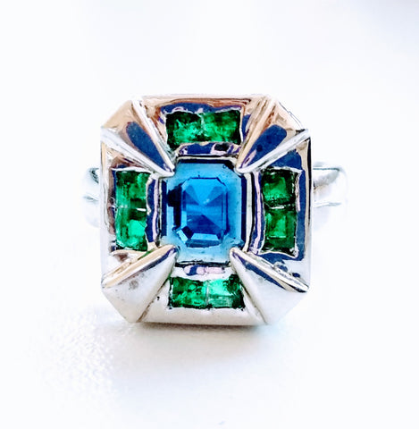 RV 355 Silver ring in an art deco design from the Queen's Era with rich green princess cut Emeralds and Royal blue sapphire dominating the centre